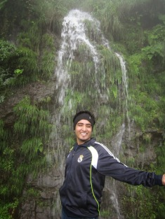 Happy Me right before bathing in the waterfall behind